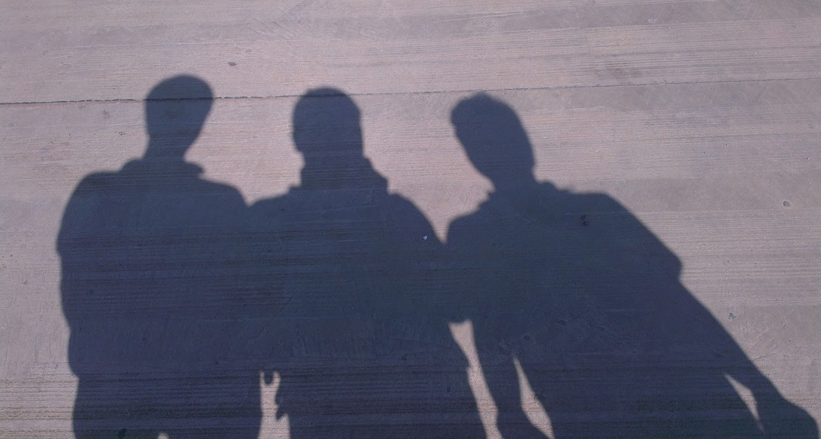 The Shadow of Three